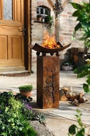 rusty metal tiki torches with rusty metal gears in the place of