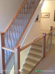 Space Between Stair Spindles by The Embedded Glass On This Landing Contrasts With The Twisted