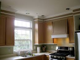 How To Make Kitchen Cabinets Look New Remodelando La Casa Adding Moldings To Your Kitchen Cabinets