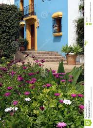 spanish house in pueblo with blue walls and yellow trim stock