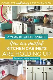 how to clean yellowed white kitchen cabinets update on our diy white painted kitchen cabinets 2 years later