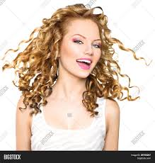 beauty model with blowing blonde curly hair portrait