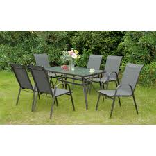 furniture back yard with black iron dining set placed on lawn