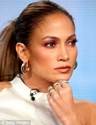 jlo earrings glows in satin skirt at q a for american idol
