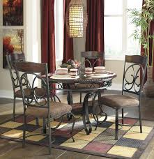 ashley dining room chairs signature design by ashley glambrey brown 5 piece dining room set