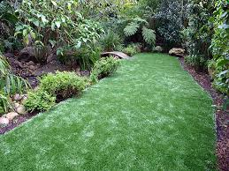 fake grass carpet kahuku hawaii landscape rock backyard