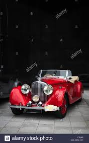 bentley cream a bright red 1930s bentley drophead coupe classic british car with