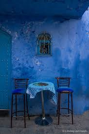 blue city morocco chair window over table for two chefchaouen morocco lindley johnson