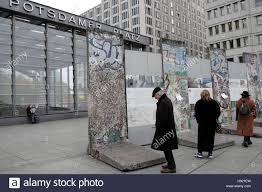berlin wall sections people reading information panels at the berlin wall sections on