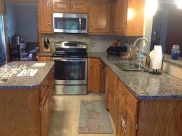 maple cabinets with granite countertops new caledonia granite countertops new granite with maple cabinets