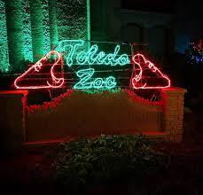 when does the lights at the toledo zoo start holiday happenings