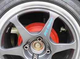 red painted brake drums