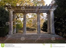 roman style pagoda with pillars and trellis stock photos image