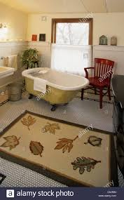 old fashioned cast iron clawfoot bathtub in bathroom of 1920 u0027s