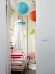 kids room toddler room with curtains and double bed