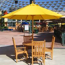 Wooden Solar Lights by Light Yellow Patio Umbrella With Brown Wooden Stand Placed On The