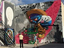 Mural Artist by The Houston Urban Experience Mural Festival Is A Place Street