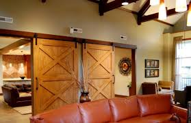Hanging Sliding Barn Doors by Interior Brown Wooden Double Sliding Barn Door Hanging On Black