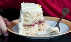 white chocolate layer cake with cranberry filling and orange