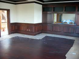 dining room with light wood floors and dark paint wood floors