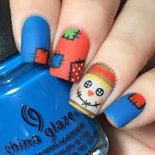 picture of scarecrow matte nails for thanksgiving and fall