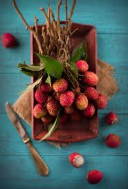lychee fruit inside lychee ice cream with praline almonds the white ramekins