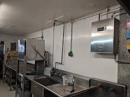 what to put on top of kitchen wall cabinets top contractor tips building with commercial kitchen wall