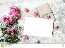 bouquet of roses with a blank greeting card and envelope stock