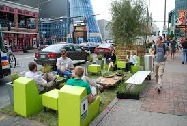 space seating metered parking spaces are transformed into miniature parks for park