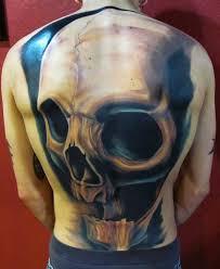 grey and black 3d skull on back