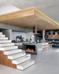 Modern Kitchen With Island Open Staircase Serves As Partition Open Stairs Kitchens And Modern