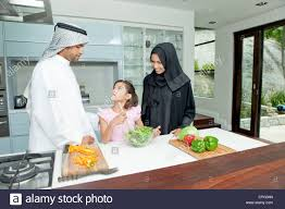 arab parents with daughter cooking in the kitchen boy playing at