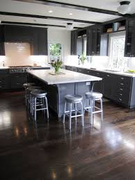 white kitchen cabinets with dark color wood floordesign ideas