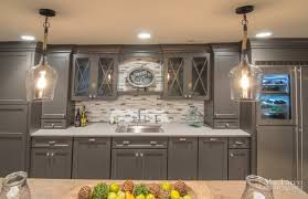 furniture wood painted cabinets with white quartzite countertops