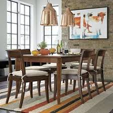 crate and barrel farmhouse table simpli home warm shaker medium storage cabinet honey brown dining