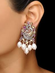 peacock design earrings buy pink dual tone brass earrings with peacock design online at