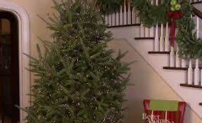 how to light a christmas tree easy tips for decorating a christmas tree better homes gardens