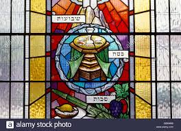 seder cup stained glass window of passover table seder plate and cup stock