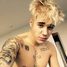 why does justin bieber have tattoos and what do they mean quora