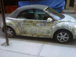 car wrapped in wrapping paper increase income by wrapping your car cbs news