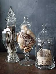 fill apothecary jars with feathers shells rocks etc for a