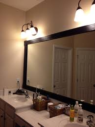 gray wall paint mirror with wooden frame wall lamps small white