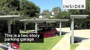 garage for cars this two story parking garage is like a bunk bed for cars youtube