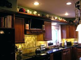 ideas for decorating above kitchen cabinets kitchen cabinet top decor ideas for decorating the of cabinets