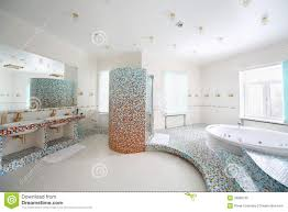 two sinks and jacuzzi with stairs in bathroom royalty free stock