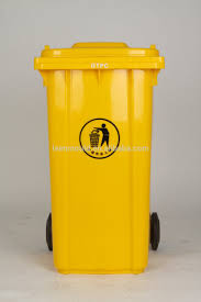 big yellow garbage bin or trash can with black wheels stock photo