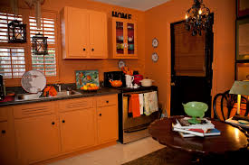 Orange Kitchen Cabinets Orange Kitchen Cabinet Design With Backsplash And Pendant Lamps