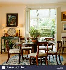 a country style dining room with french doors leading outside