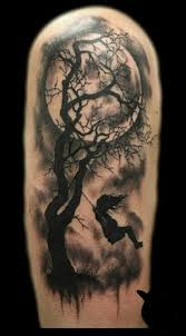 dead tree and moon tattos for