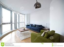 modern living room with floor to ceiling windows stock photography